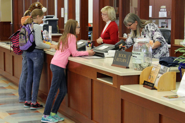 Customer service desk at the Seward Public Library. (Photo by Mike Tobias, NET News)