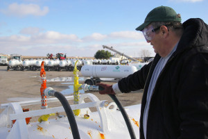 Mike Burnham, plant manager at West Central FS in Adair, Illinois, fills a storage tank with anhydrous ammonia. Corn farmers demanded half of the 12.8 million tons of nitrogen fertilizer consumed in the U.S. in 2015. (Photo courtesy of Harvest Public Media/Inside Energy)