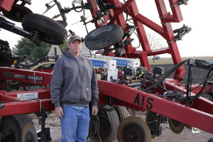 Wickert custom applies anhydrous ammonia for corn farmers in the fall and spring. This 21-knife fertilizer rig, pulled by a tractor, costs about $100,000. (Photo courtesy of Harvest Public Media/Inside Energy)