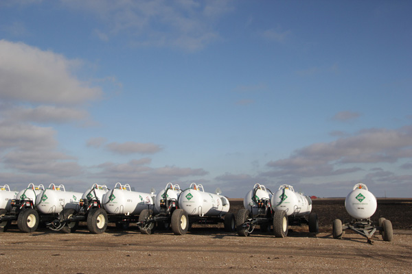 Anhydrous ammonia is the cheapest form of nitrogen fertilizer on the market. But because it's dangerous to handle and difficult to apply, farmers often hire out custom applicators who work for local fertilizer dealers to do the job. (Photo courtesy of Harvest Public Media/Inside Energy)