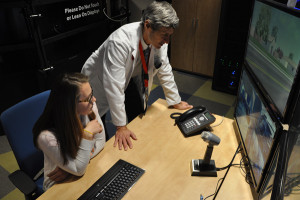 Dr. Matthew Rizzo (right) reviews data with Hannah Maher, a clinical research associate. Dr. Rizzo said his team also uses devices to track a patient's driving habits in their own cars, to get a more accurate picture of driving habits. (Photo by Ryan Robertson, KVNO News)
