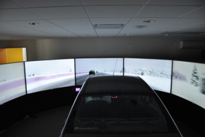 The six high-fidelity screens provide the driver with 290 degrees of simulated environment. (Photo by Ryan Robertson, KVNO News)