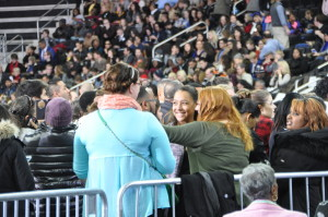 People chat as they await President Obama's arrival. (Photo Courtesy Bill Grennan)