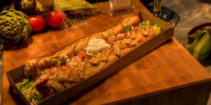 Food is an obvious point of emphasis at the College World Series. This foot long, southwestern chimichanga ($18) is said to be a new fan favorite. (Photo by Ryan Robertson, KVNO News)