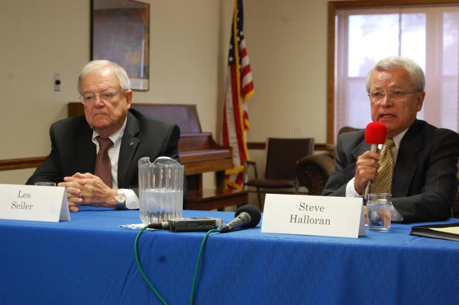 Sen. Les Seiler listens to challenger Steve Halloran at a Hastings candidates' forum. (Photo by Fred Knapp, NET News)